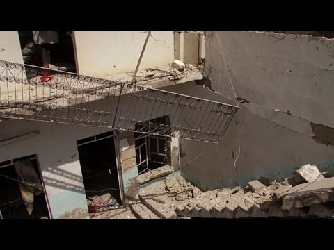 Air strike in Syria's Aleppo turns homes into rubble