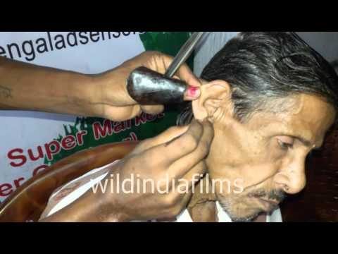 Roadside ear wax cleaning : Weird jobs in India