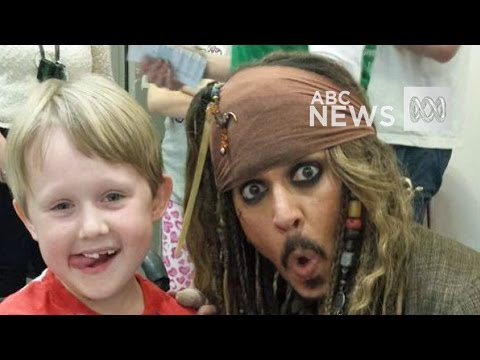 Johnny Depp takes selfie with seven-year-old Max Bennett