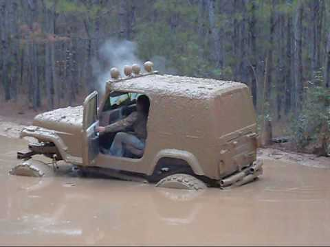 redneck jeep wrangler in the mud bog mudrun jedburg