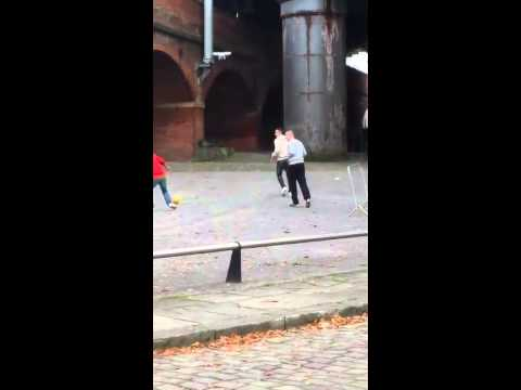 Robin van persie playing football with kids under a drone in manchester