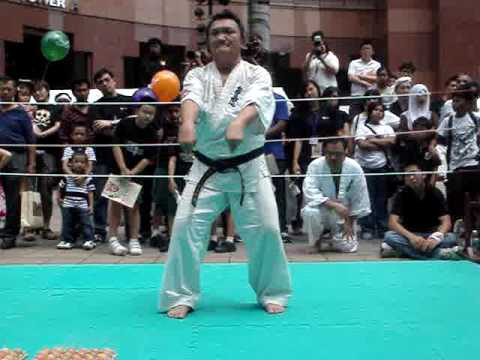 singapore budokan kyokushin karate demo (part 5)-standing on eggs while breaking brick Image 1