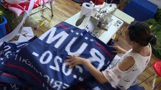 As trade war wages, Trump flags fly out of China factory