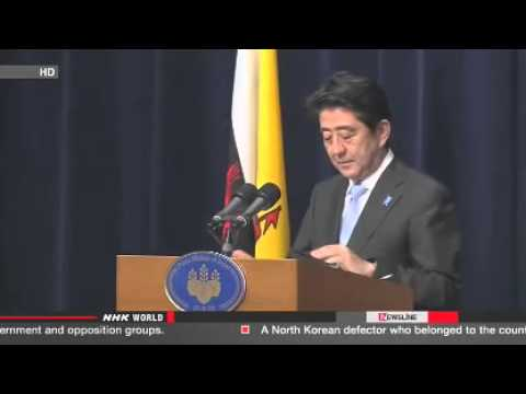 Abe  Resolve S China Sea issues based on law