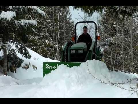 SnohoG tractor snowplow