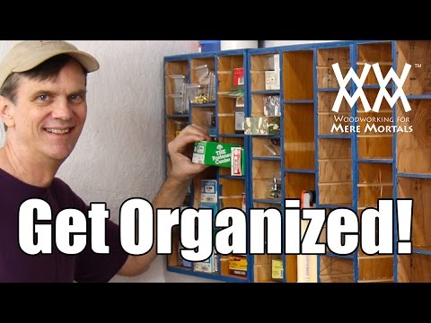 Organize hardware in this cubby hole storage cabinet. Made from recycl...