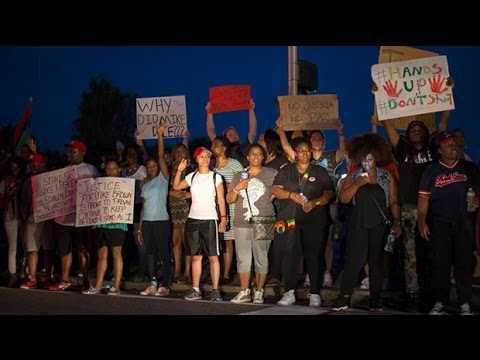 Protesters march over Ferguson shooting