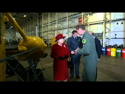 Prince William shows Queen Elizabeth II an RAF Search and Rescue helicopter