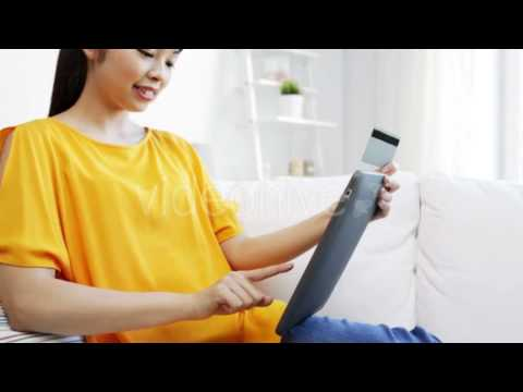 Happy Asian Woman With Tablet Pc And Credit Card - Stock Footage | VideoHive 15556778