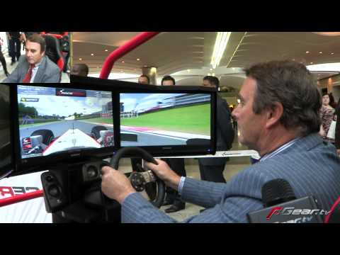 Nigel Mansell playing F1 video game