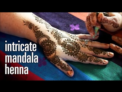 Demonstration of intricate henna mandala pattern - Mumbai style mehndi inspiration