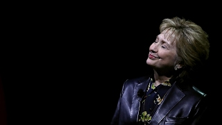 Hillary Clinton urges voters to combat Trump policies: 'Resist, insist, persist and enlist' – video