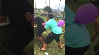 Guys Play Hilarious Balloon Popping Game