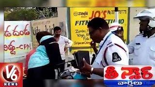 Woman Attacks On Hyderabad Traffic Police | Teenmaar News