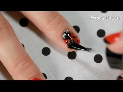 Learn how to create a ladybug nail design in this nail art tutorial