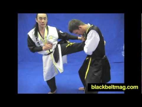 Korean Martial Arts: Hwa Rang Do Grandmaster Taejoon Lee Demonstrates a Leg-Grab Counter Image 1