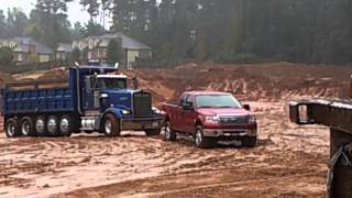 Ford f150 pulling out in the mud a stuck dump truck !!!
