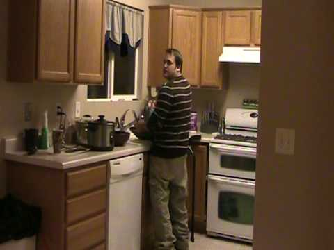 T12 Complete Paraplegic Doing the Dishes while Standing Up in Leg Braces Video