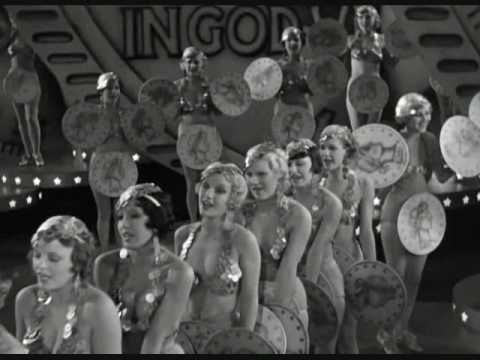 The famous opening song from the film Gold Diggers of 1933, performed by Ginger Rogers. All musical scenes in the film, including this one, were choreographe...