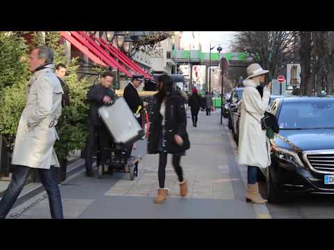 Chic Parisians and tourists, a stroll on Avenue Montaigne. Top designer shopping street in Paris.