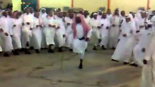 Cool elderly man dancing in a marriage in Saudi