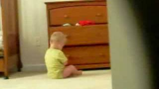 Boogies climbs out of crib.