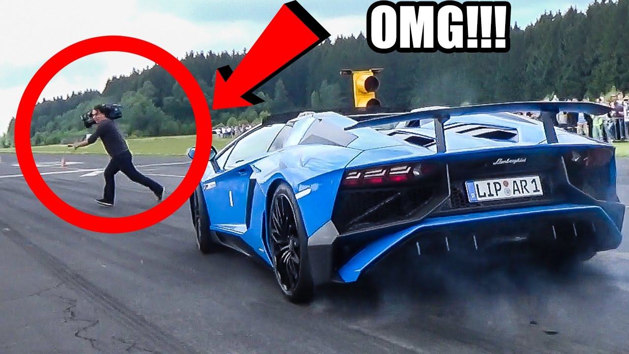 [Cameraman Nearly Gets Splattered By Lamborghini] Video