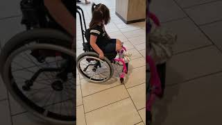 Serenity being silly with her wheelchair