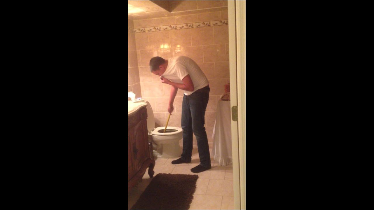 Plunging Toilet Kid Plunges Toilet And Throws