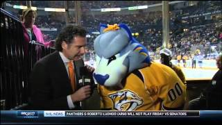 Predators mascot Gnash puts a pie in the face of Gene Principe 11/27/14