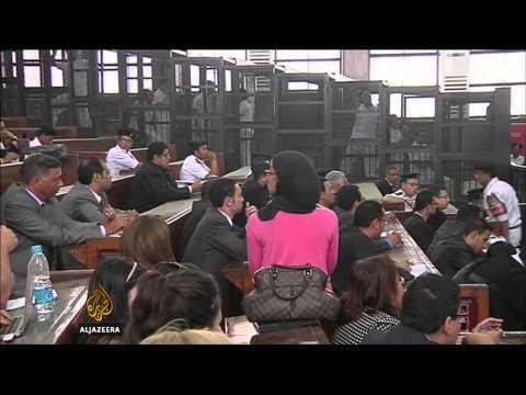 Imprisoned Al Jazeera journalists back at court