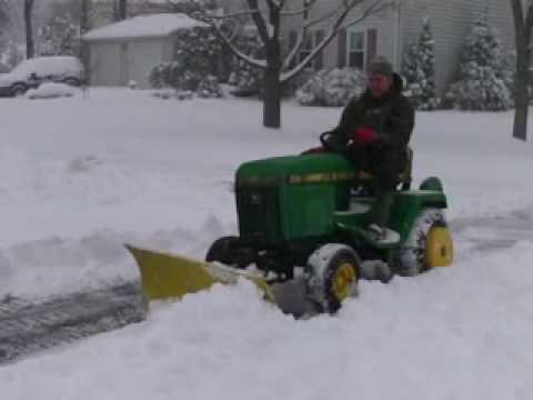 John Deere 318 Plowing Snow