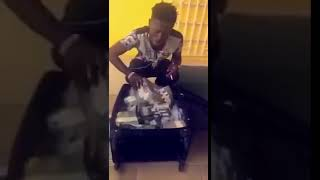 Shatta Wale flaunts bundles of money on social media