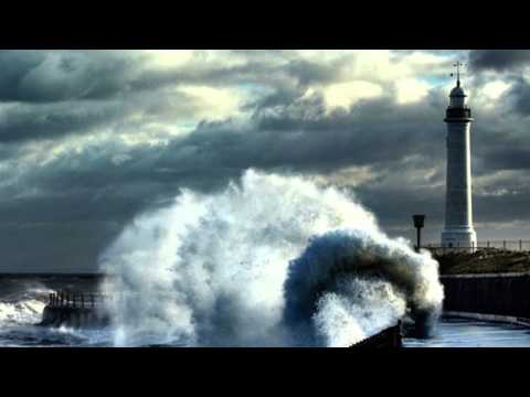 Waves Crashing Into Lighthouses