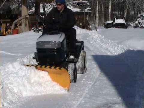 Lawn mower snow plow