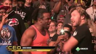 Kenny Omega and Xavier Woods face to face