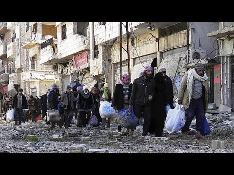 Syria evacuation of Homs continues