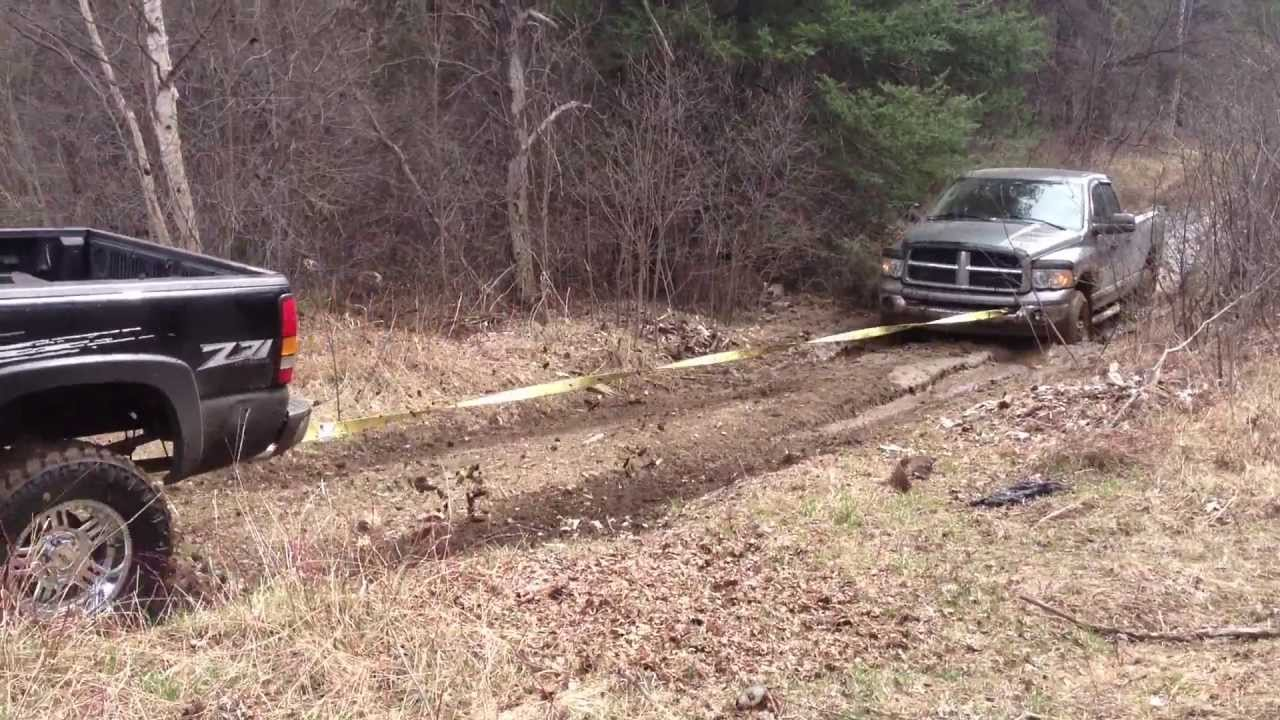 Lifted Gmc Sierra 1500 Pulling Dodge 2500 Cummins Out Of