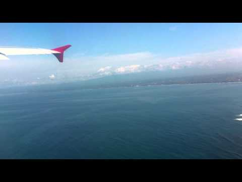 Take off from Bali Denpasar on a sunny day with Air Asia A320