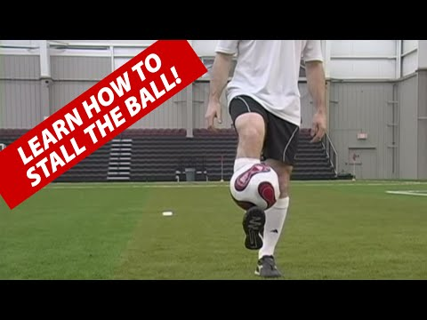 How To Stall A Soccer Ball Football On Your Foot