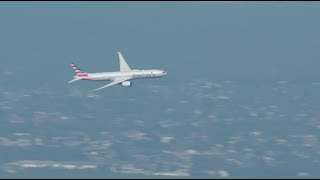 RAW: American Airlines Boeing 777-300ER flies over Sydney Harbour