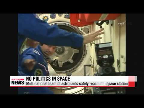 Multinational astronaut team safely arrives at ISS