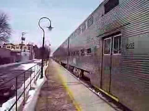 Metra MP36 405 pushes its inbound train out of Riverside heading for its next stop at Harlem Avenue.