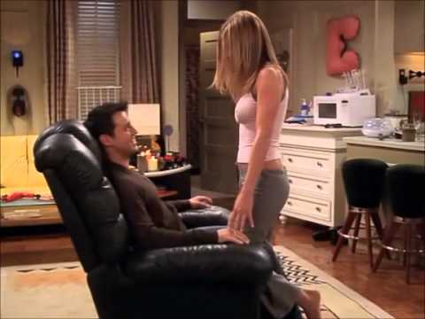 Jennifer Aniston taking off her bra