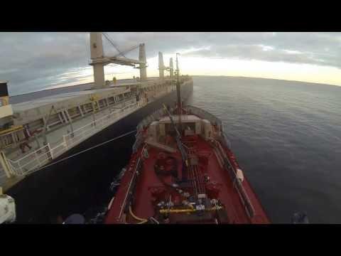 Bunker barge going alongside bulk carrier.