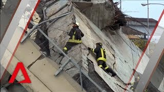 Emergency workers at the scene of collapsed bridge in Italy