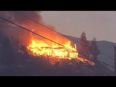 California wildfires destroy homes as threat rages on
