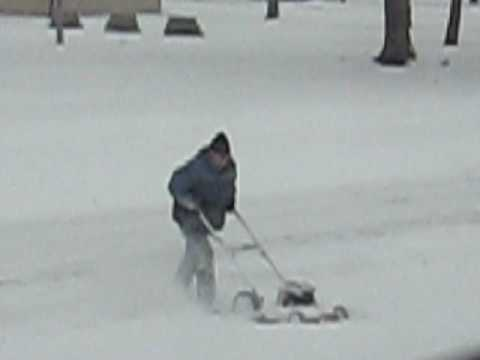 Man Uses Push Lawn Mower To Blow Snow Youtube