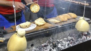 Italy Street Food. Grilling 'Caciocavallo' Cheese, Lamb and Pork Sausages