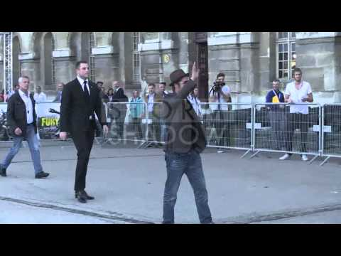 Brad Pitt greets fans at Fury Photocall in Paris